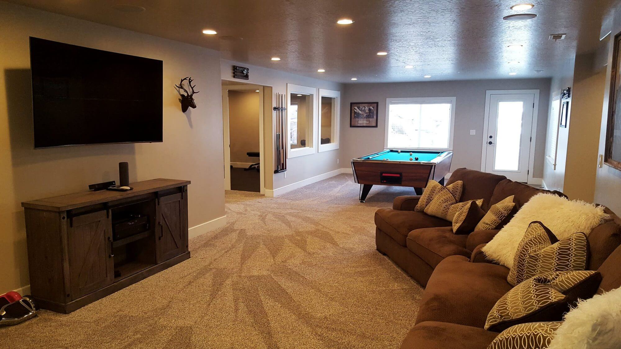 A newly finished basement done by aspire construction in utah county